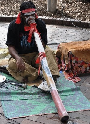 Aboriginal performer with didgeridoo